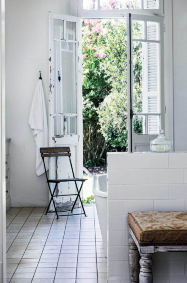 antique-bathroom-with-reclaimed-franchis-doors