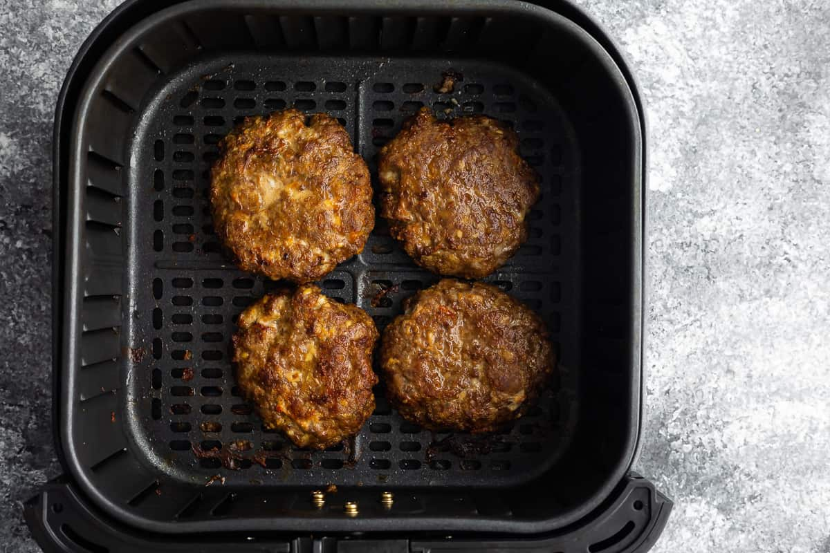 Hamburger cooked in an air fryer basket