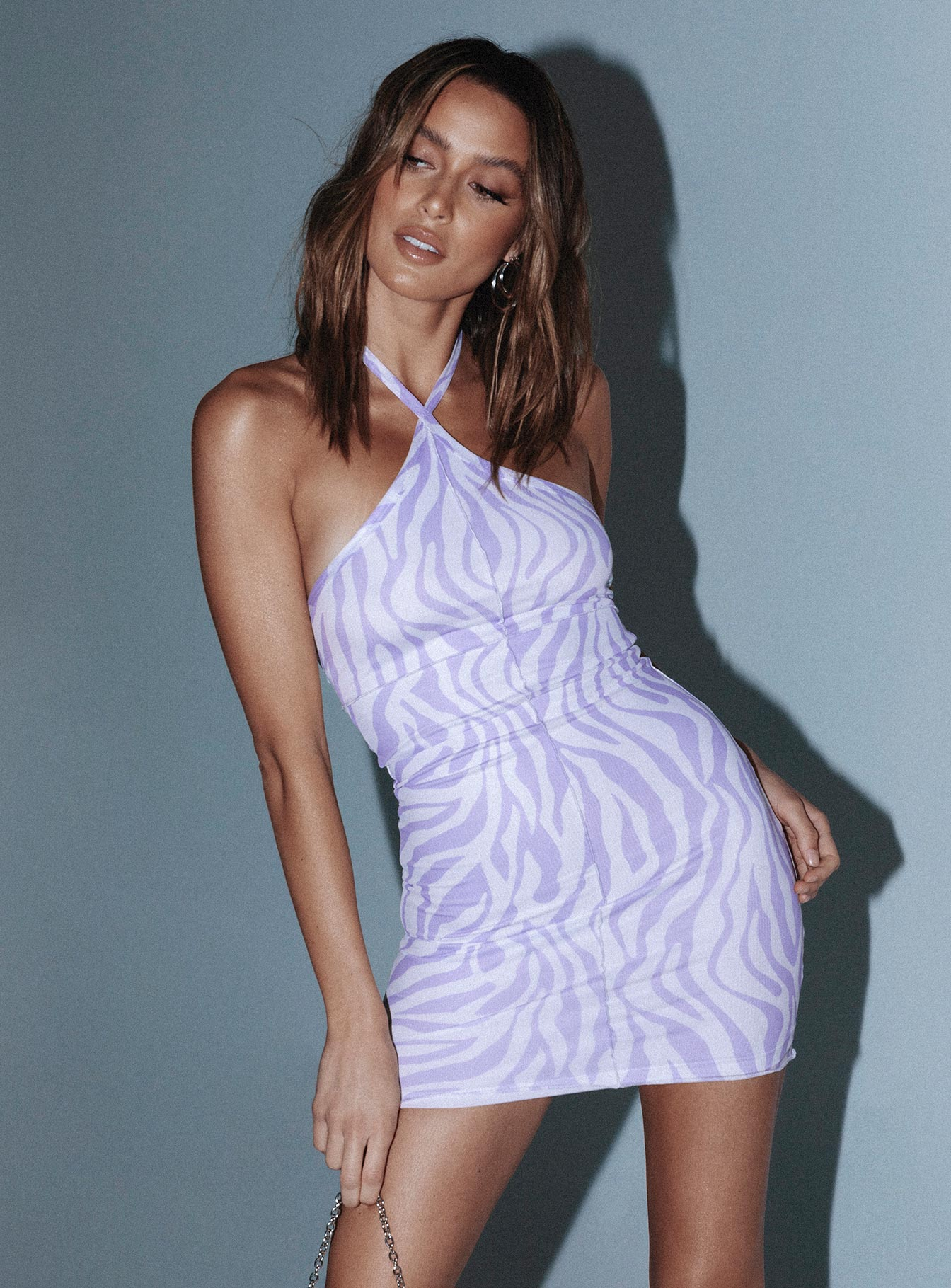 Lilac-colored halterneck dress with animal print