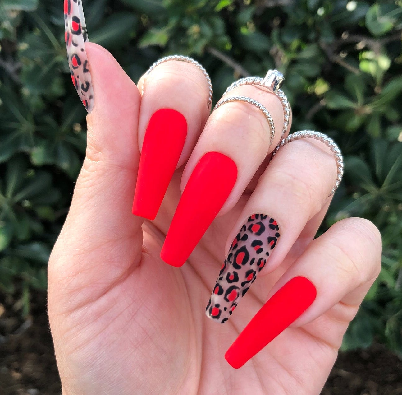 Red matte nails with a leopard print