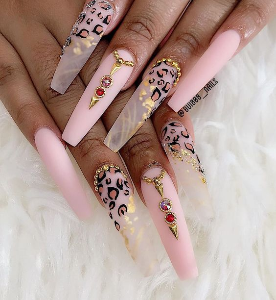 Delicate pink matte and transparent leopard nails with rhinestones