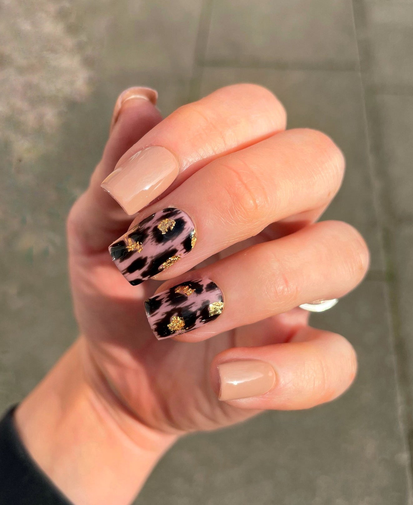 Leopard print nude nails covered with gold foil