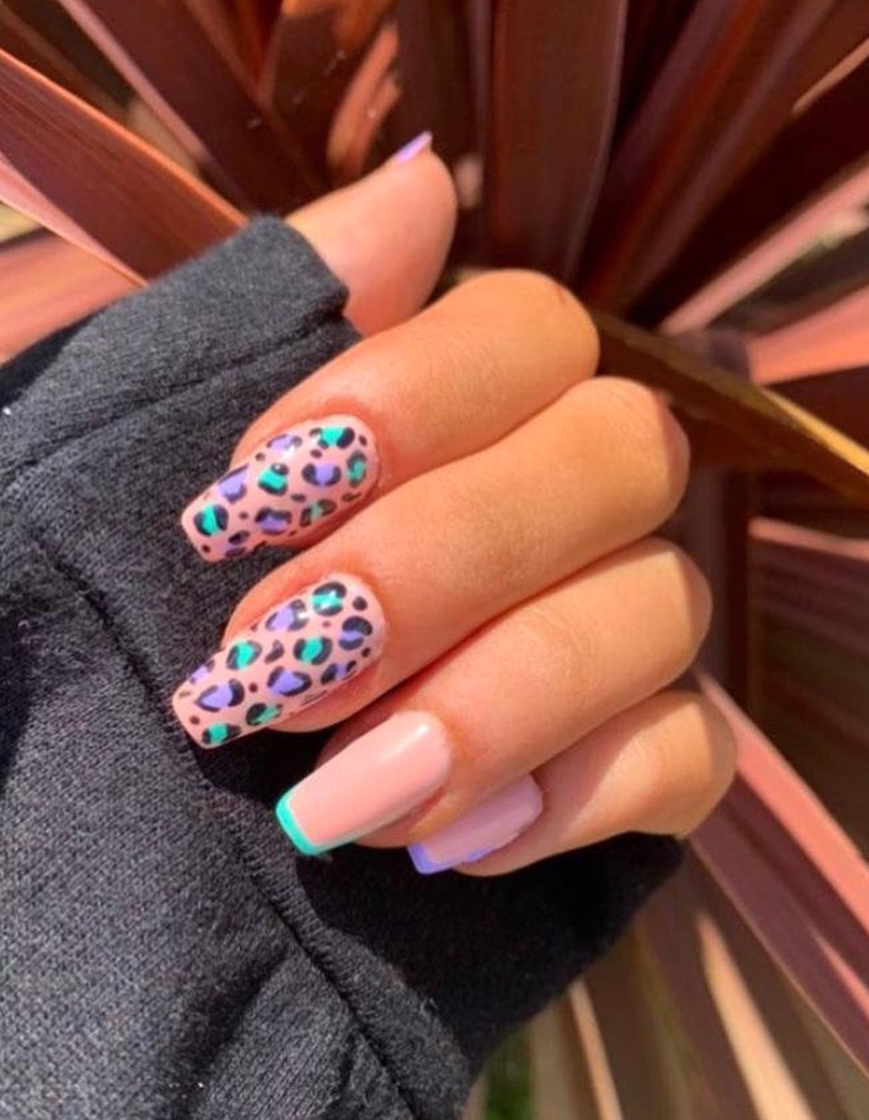 Pink, lavender, and teal leopard nails