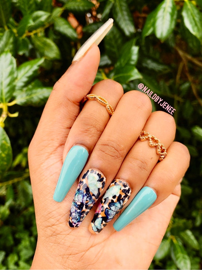 Baby blue leopard nails with butterflies