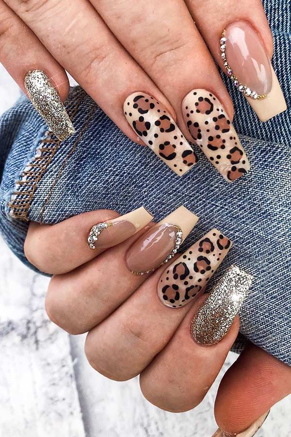 Brown leopard nails with rhinestones and glitter