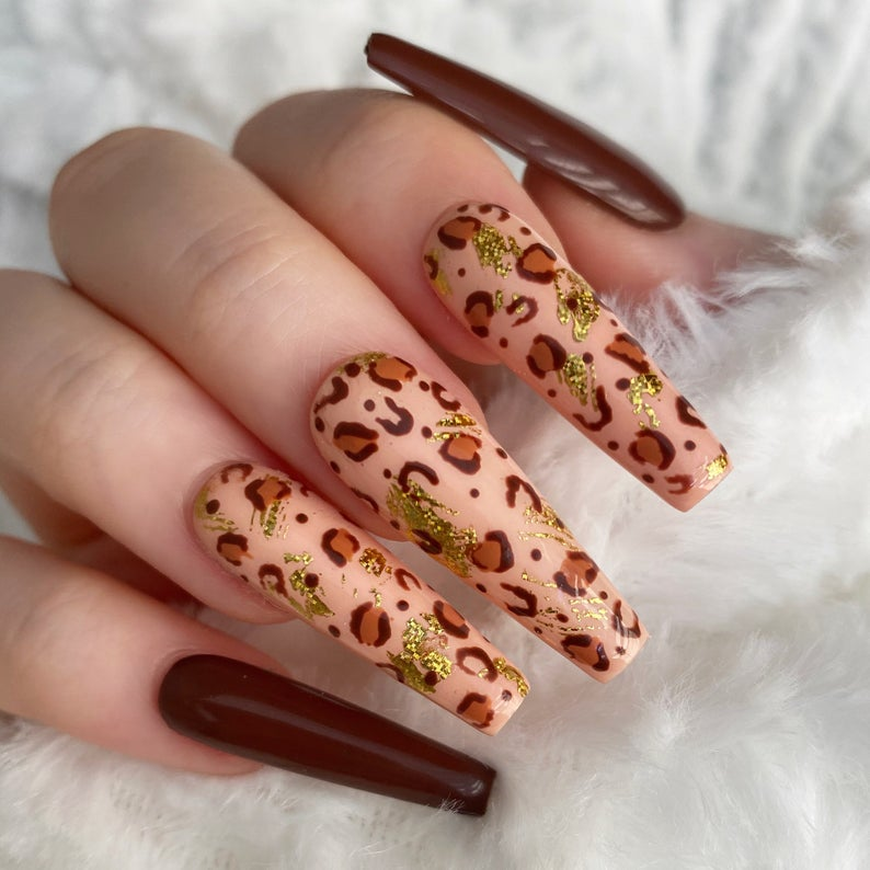 Brown leopard nails with golden spots
