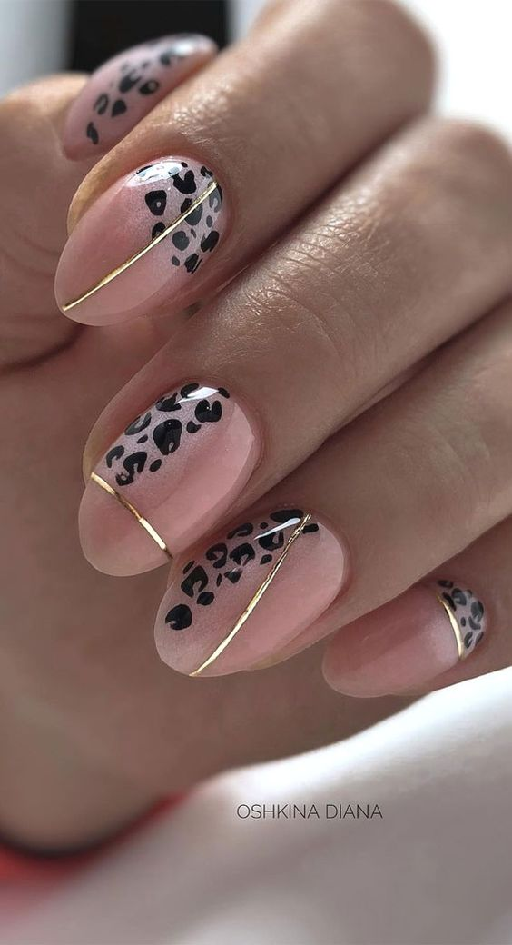 Beige leopard nails with gold stickers