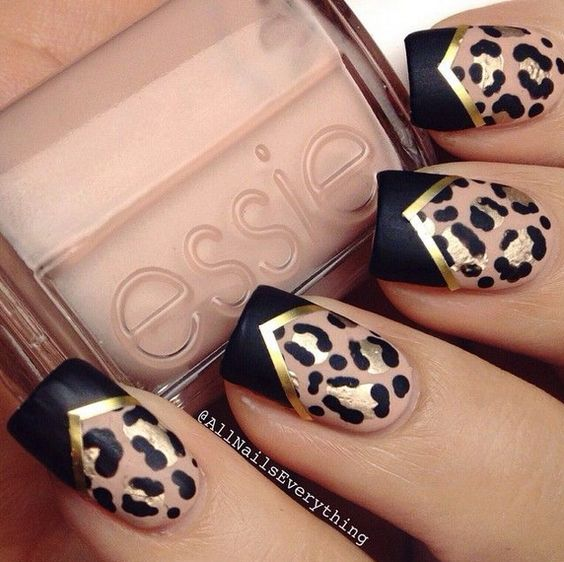 Black leopard nails with a gold pattern