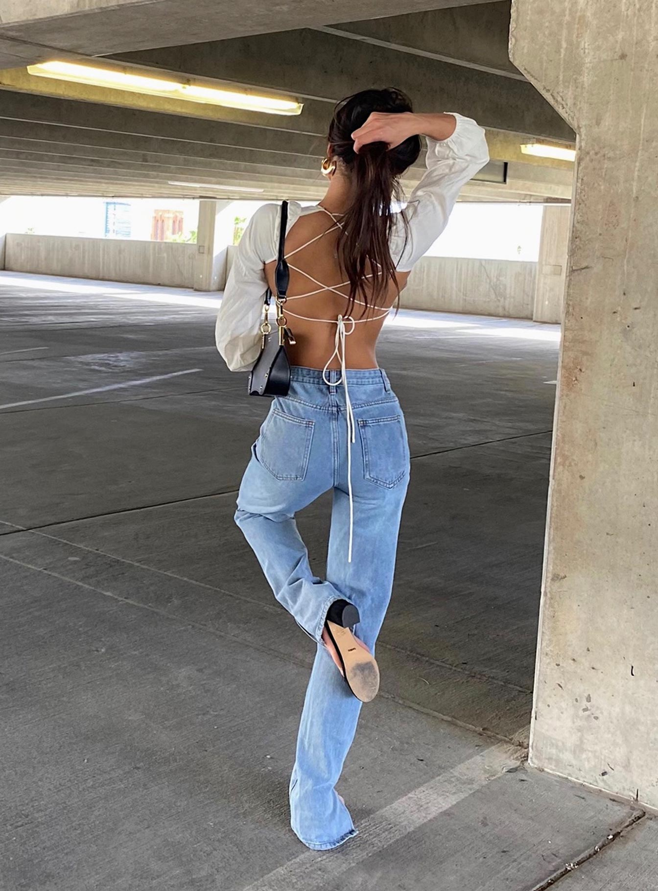 Cute, casual mom jeans outfit with a backless crop top