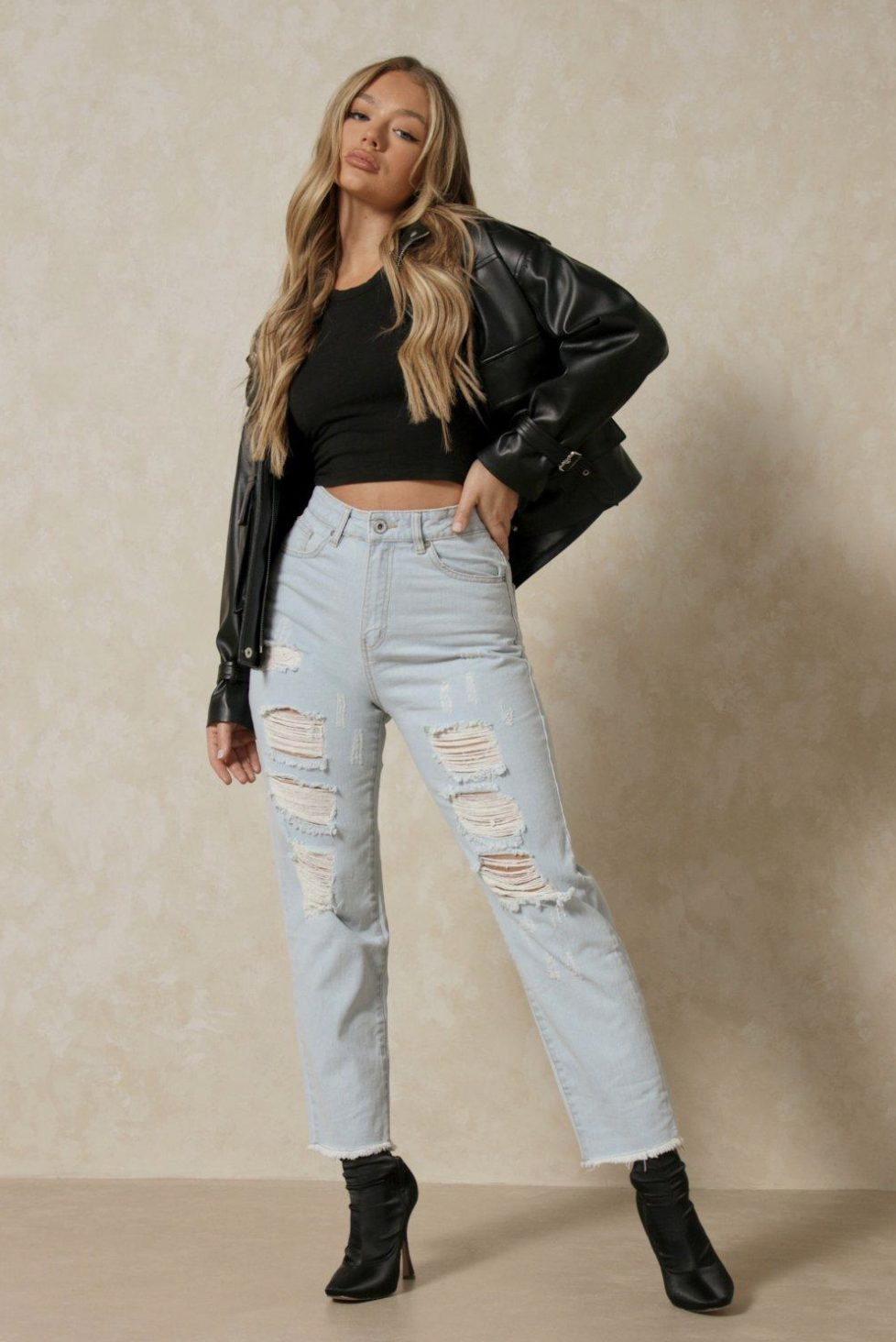 Slightly torn mom jeans with a black leather jacket