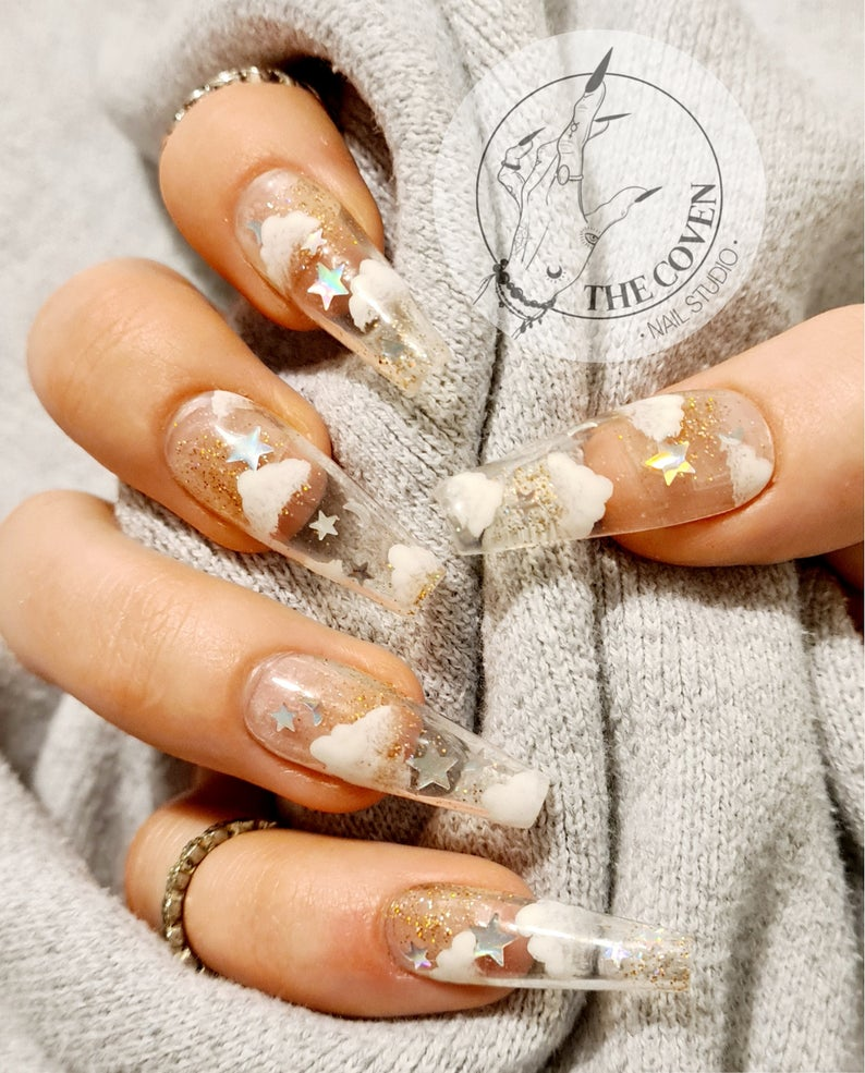 Transparent cloud nails with gold glitter and stars