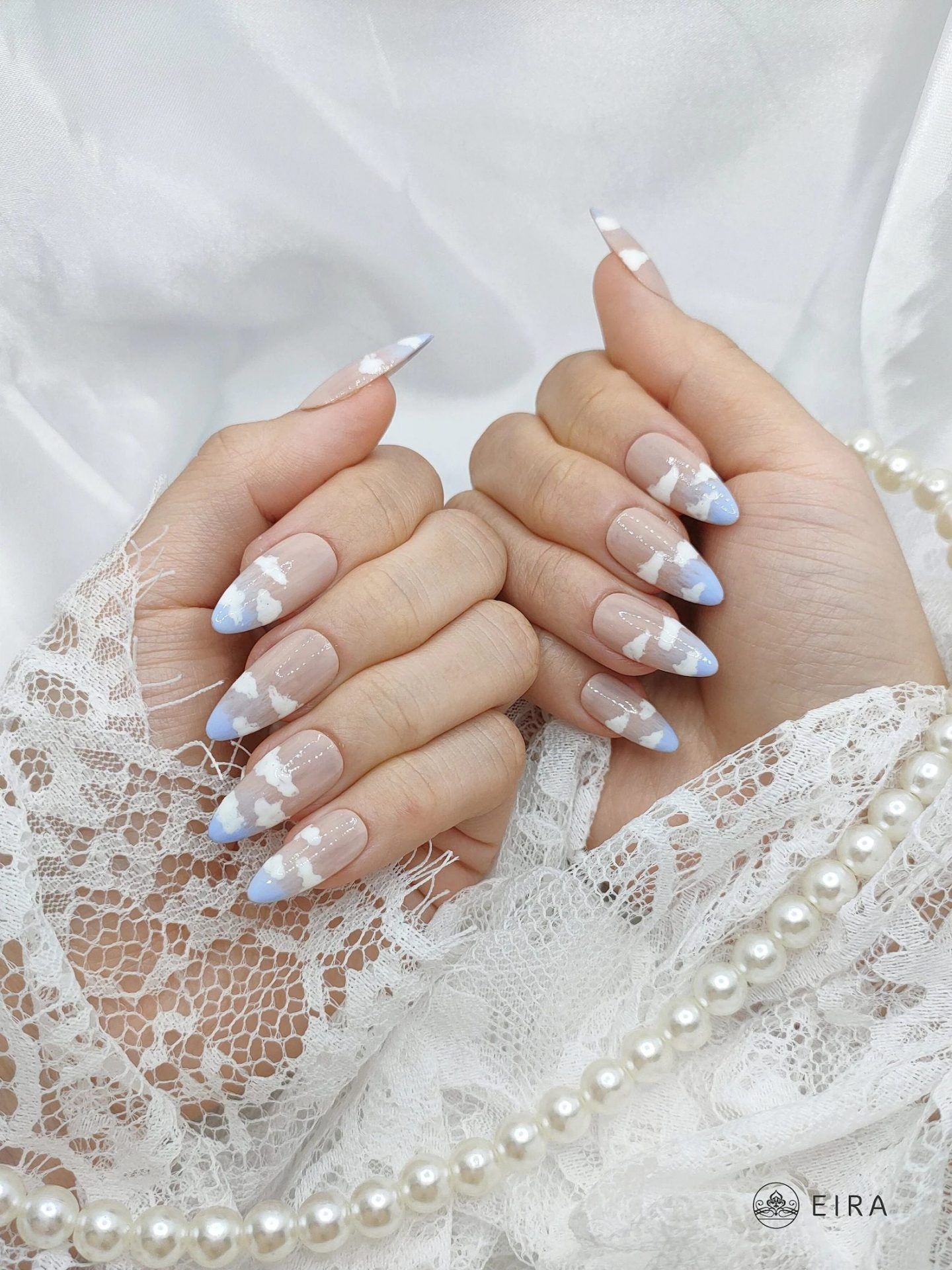 Pastel Blue French Tip Nails with Cloud Nail Art