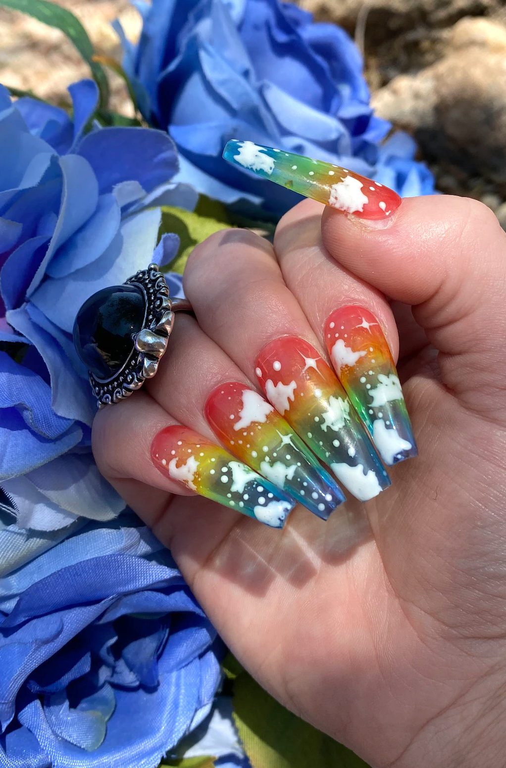 Sweet rainbow nails with cloud nail art for pride
