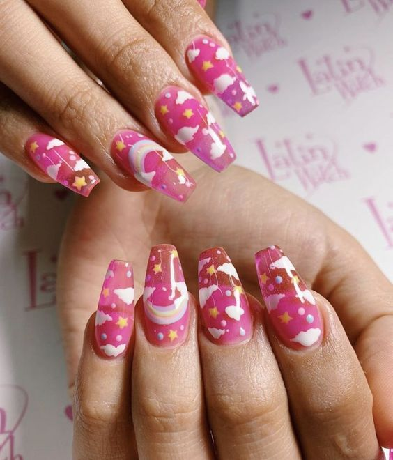 Transparent pink cloud nails with rainbow and stars