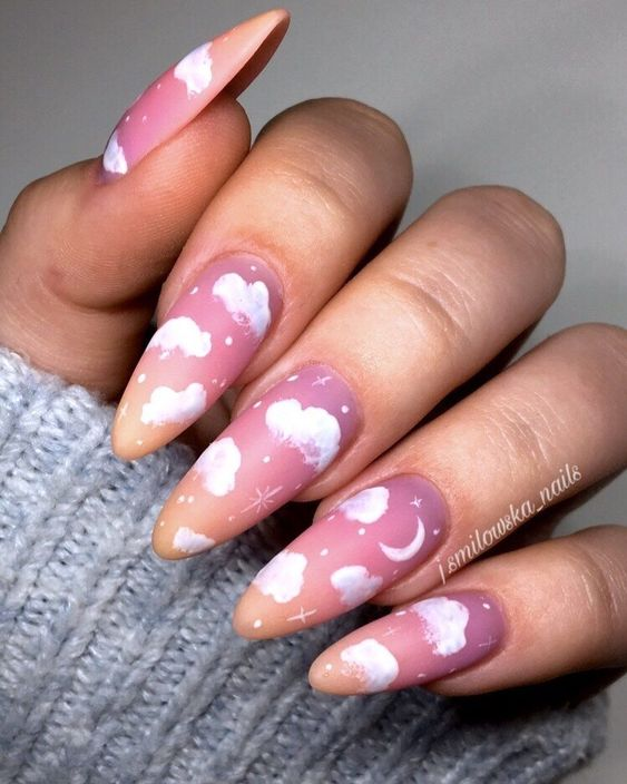 Purple, pink and yellow cloud nails with rhinestones