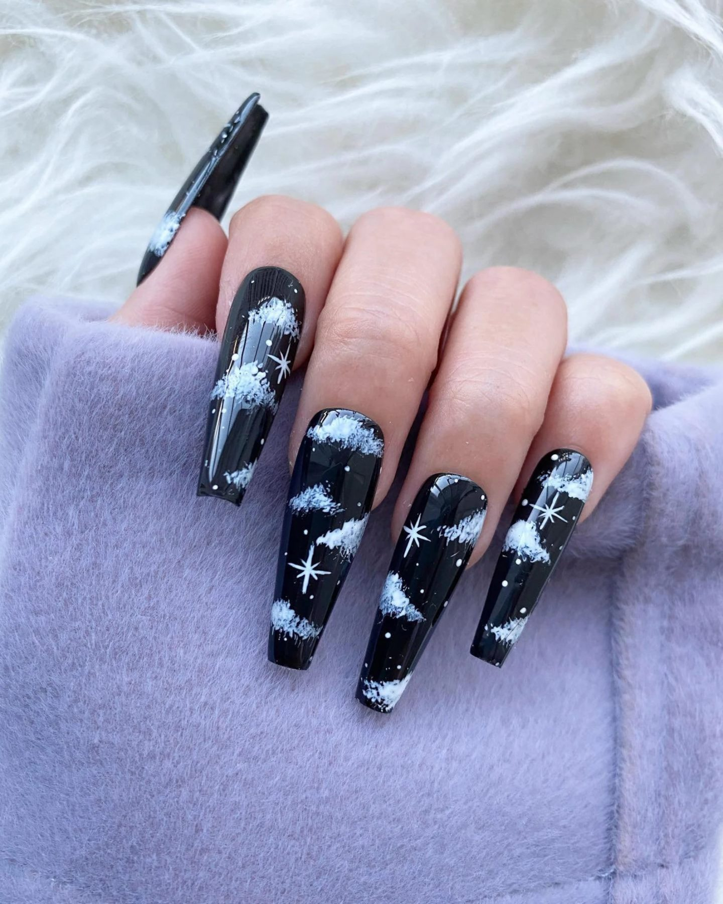 Long black coffin nails with cloud nail art