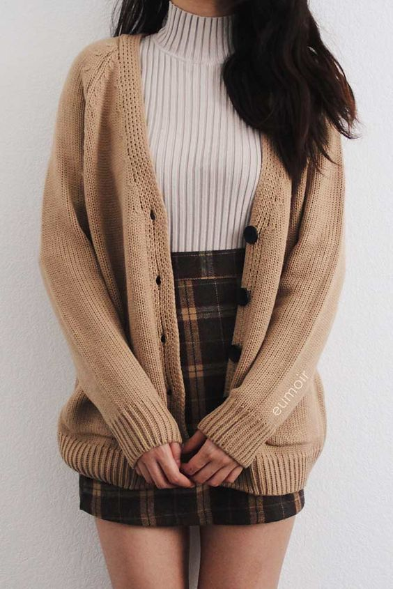 Checkered skirt with ribbed turtleneck top and brown cardigan for back to school