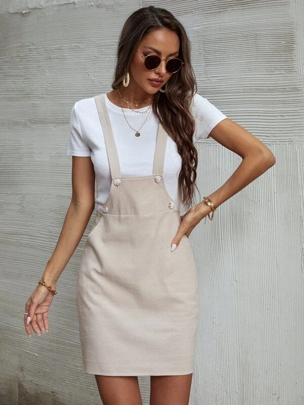 Cream colored overall dress with white t-shirt