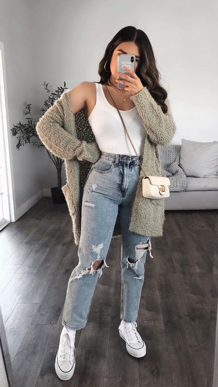 Simple white halter top with gray cardigan and ripped jeans for back to school